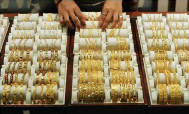 Gold weakens on global cues, sluggish demand