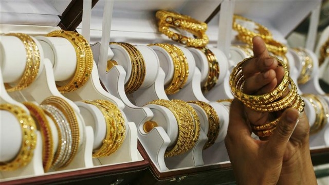 Gold prices rise as speculators enlarge positions