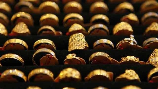 Gold futures drop Rs 295 on firm dollar