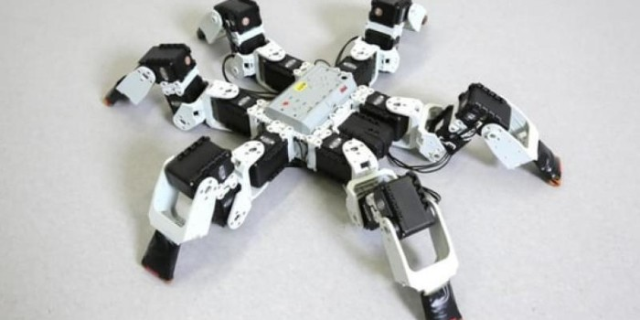 Six-legged robots faster than nature-inspired Gait